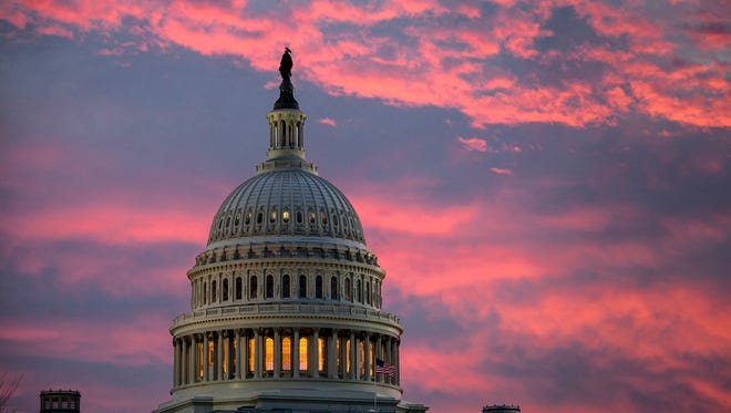 The Capitol is seen at dawn as Senate Republicans work to pass their sweeping tax bill this week, in Washington, Thursday, Nov. 30, 2017. (AP Photo/J. Scott Applewhite)