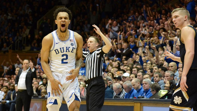 Duke Blue Devils guard Gary Trent Jr. (2) reacts after hitting a three-pointer during the second half against the Notre Dame Fighting Irish at Cameron Indoor Stadium.