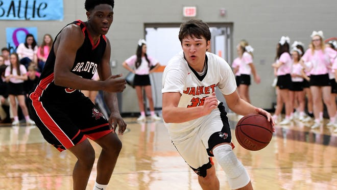 Greenfield's Levi Dees dribbles around a Bradford defender during their game, Tuesday, Feb. 6. Greenfield defeated Bradford, 50-48.