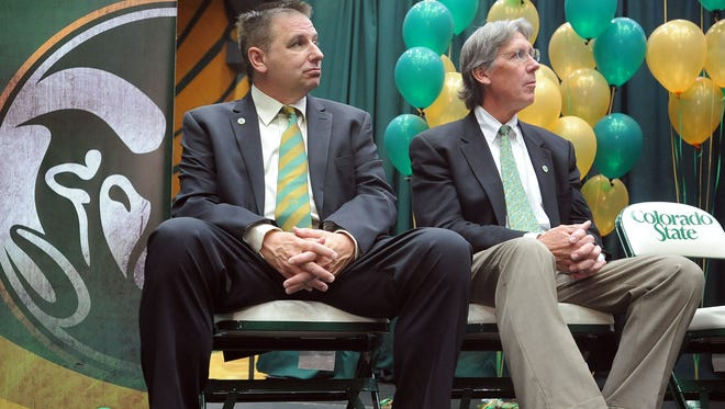 Larry Eustachy, left, sits with athletic director Jack Graham during the basketball coach's introductory news conference April 12, 2012. Graham said Tuesday he was glad to see CSU finally get rid of the coach and only wishes it had happened sooner.