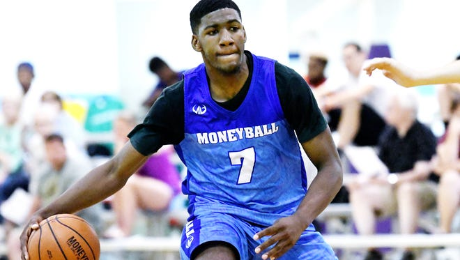 MSU freshman Aaron Henry, from Indianapolis, moves with the ball during Tuesday's Moneyball Pro-Am summer league action.