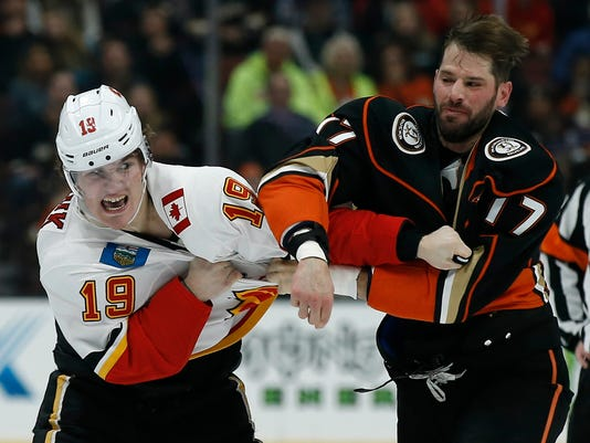 Calgary Flames left wing Matthew Tkachuk, left, fights with Anaheim Ducks center Ryan Kesler during the first period of an NHL hockey game in Anaheim, Calif., Friday, Dec. 29, 2017. (AP Photo/Alex Gallardo)