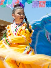 Angelina Vasquez, 8, dances with East Picacho Ballet Folkorico on Saturday, May 5, 2018 during the Cinco de Mayo Fiesta at the Mesilla Plaza.