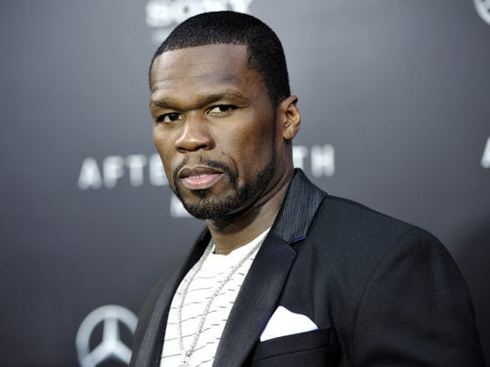 "FILE - In this May 29, 2013, rapper Curtis ""50 Cent"" Jackson attends the ""After Earth"" premiere at the Ziegfeld Theatre, in New York. Jackson has been charged with attacking his ex-girlfriend and trashing her Los Angeles condo last month. City Attorney Mike Feuer said Wednesday, July 3, 2013, the 37-year-old ""In da Club"" singer is charged with domestic violence and vandalism. (Photo by Evan Agostini/Invision/AP, File) ORG XMIT: CAENT996"