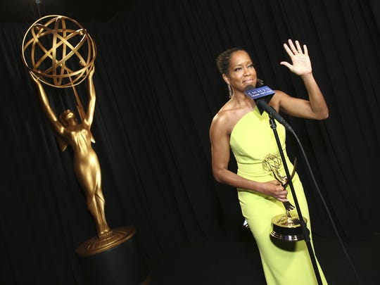 """Regina King poses with the award for outstanding lead actress in a limited series, movie or dramatic special for """"Seven Seconds"""" backstage at the 70th Primetime Emmy Awards on Monday, Sept. 17, 2018, at the Microsoft Theater in Los Angeles. (Photo by John Salangsang/Invision for the Television Academy/AP Images)"""