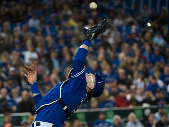 Toronto Blue Jays catcher Danny Jansen (9) catches a pop fly for an out by Boston Red Sox's Christian Vazquez  during the fourth inning of a baseball game in Toronto on Thursday, May 23, 2019. (Nathan Denette/The Canadian Press via AP)