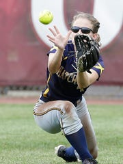 Tomahawk's Taylor Shilts makes a diving catch Friday afternoon during the team's Division 3 state semifinal game against Prescott at Goodman Diamond in Madison.