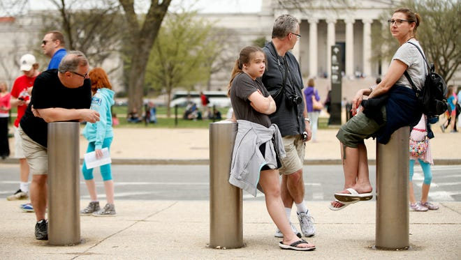 Visitors wait for the Smithsonian's National Air and Space Museum to reopen after a power outage on April 7 in Washington, D.C.