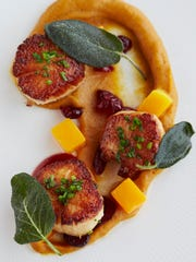Seared sea scallops with butternut squash confit, pickled