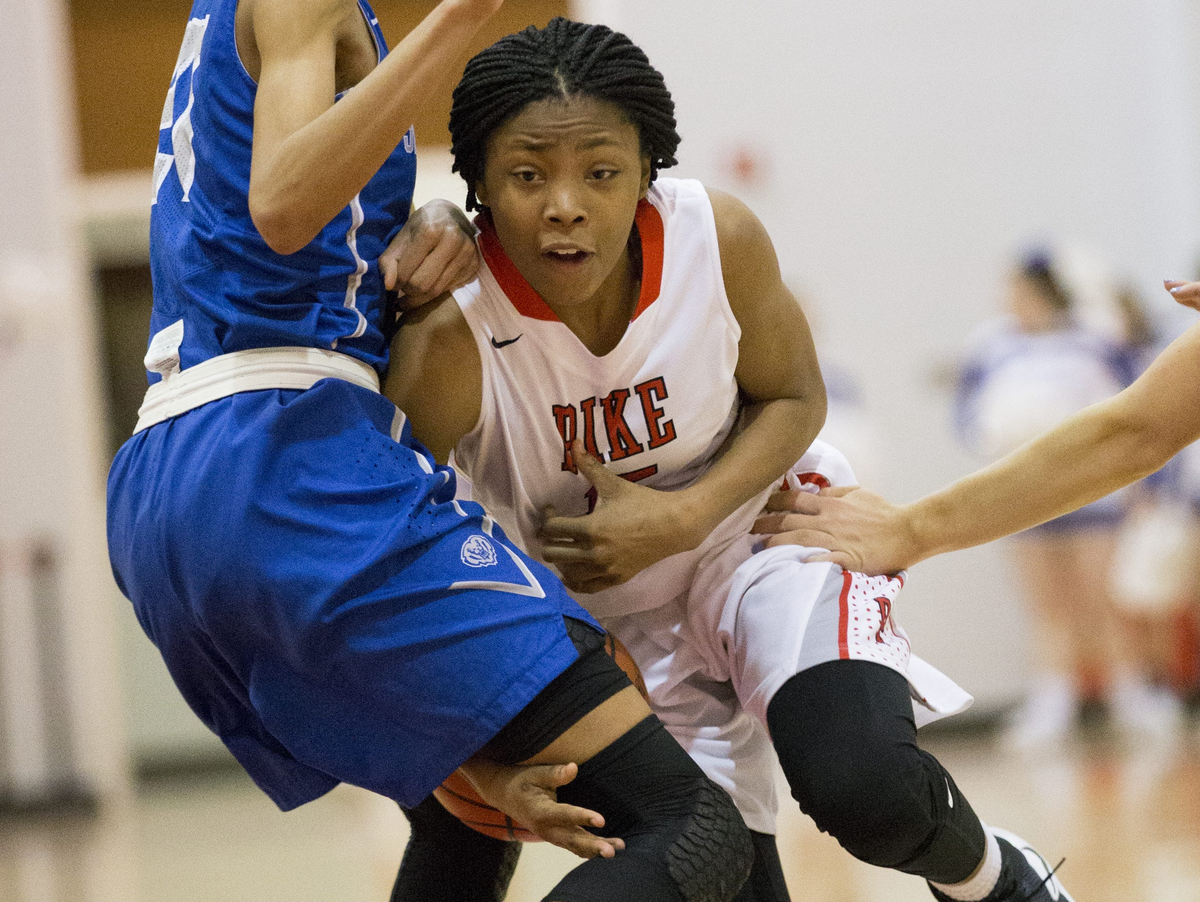 Angel Baker of Pike High School, loses a ball as she collides with a Hamilton Southeastern High School player, at Pike High School, girls basketball, Indianapolis, Tuesday, January 24, 2017. Pike won 62-58.