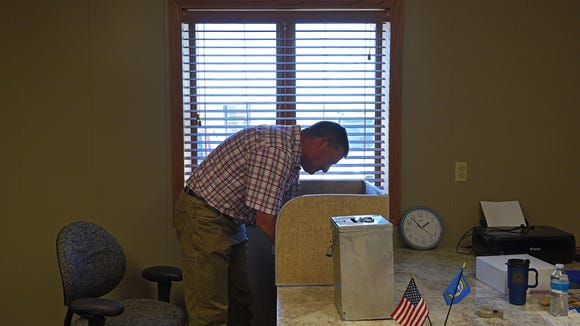Gary Miles fills out a ballot during the West Central School District's opt-out election Tuesday, Sept. 27, 2016, at the Wall Lake Township Hall west of Sioux Falls.