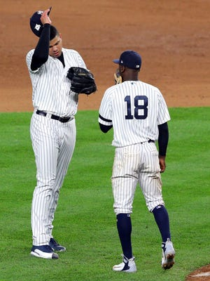 Yankees shortstop Didi Gregorius talks to relief pitcher Dellin Betances during the ninth inning against the Houston Astros during Game 3 of the 2017 ALCS playoff baseball series at Yankee Stadium.