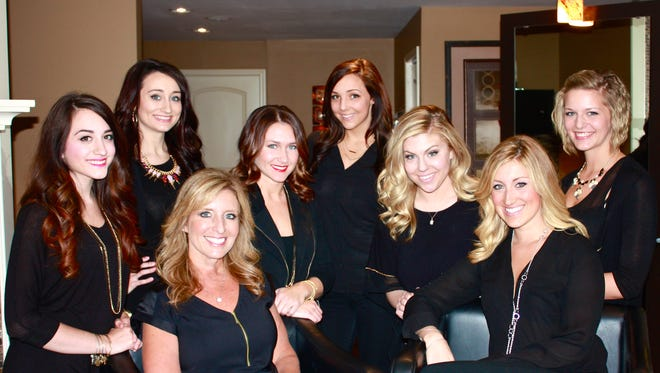 Lori Ashley Salon staff with owners Lori Morgan, bottom left, and Ashley Morgan, second from right.