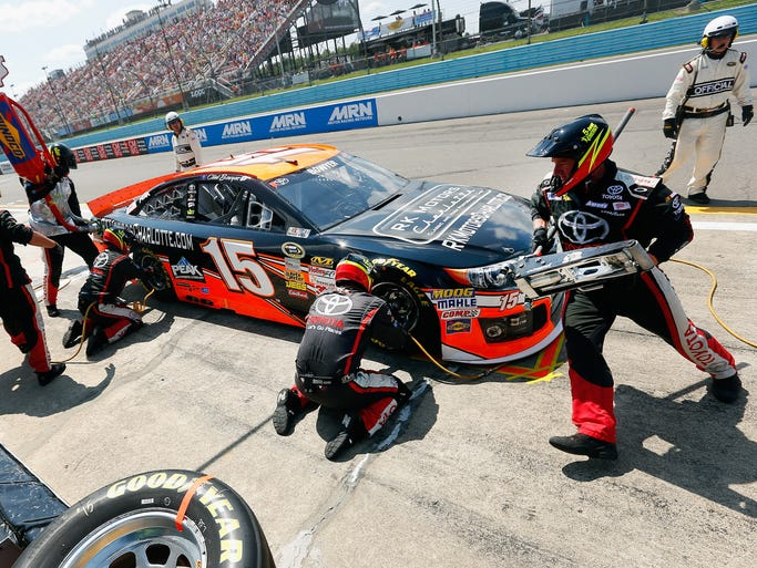 WATKINS GLEN, NY - AUGUST 10:  Clint Bowyer, driver of the #15 RK Motors Charlotte Toyota, pits during the NASCAR Sprint Cup Series Cheez-It 355 at Watkins Glen International on August 10, 2014 in Watkins Glen, New York.  (Photo by Tom Pennington/Getty Images)