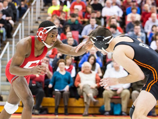 Cornell's Nahshon Garrett, left, shown in January 2013 against Oregon State's Joey Palmer, is a three-time All-America selection. He has moved up to 133 pounds for his senior season after wrestling at 125 his previous three.
