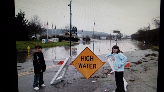 Anderson Township resident Barry Bryan shared photographs of his children standing in front of flood waters on Kellogg Avenue in 2005 and this year. Here are Cole and Megan Bryan in 2005.