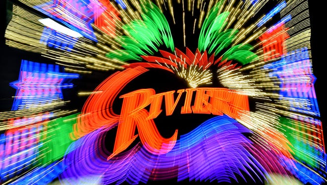 A slow-shutter camera zoom effect image shows an exterior view of the Riviera Hotel & Casino on its last day of operation on May 3, 2015 in Las Vegas, Nevada. The Las Vegas Convention and Visitors Authority purchased the 60-year old property on the Las Vegas Strip for $182.5 million and plans to demolish it to make room for more convention space as part of its $2.3 billion Las Vegas Global Business District project. The hotel close on May 4, 2015.