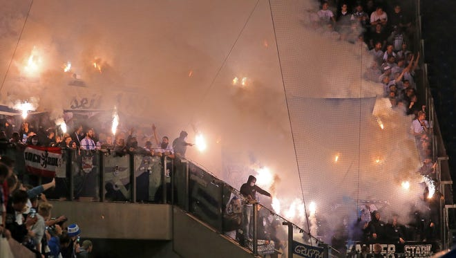 Supporters of Berlin use pyrotechnical articles during the DFB Cup first round match between FC Hansa Rostock and Hertha BSC.