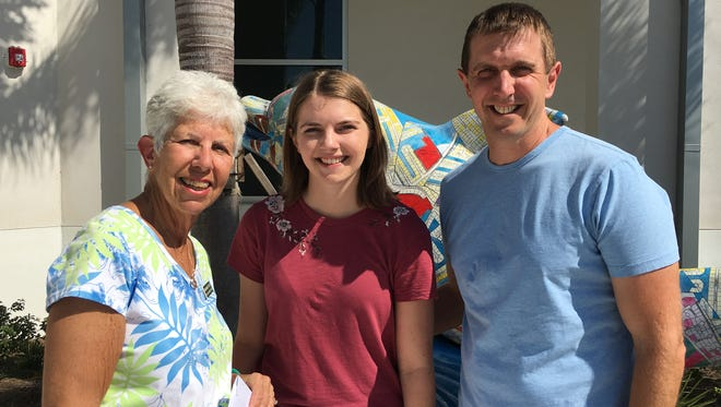 Marianne Foley, the Garden Club's scholarship chairperson, presented the $750 check for college expenses to Maddie on April 12, while her father Kyle Grucci looked on. From left, Foley, Madeline Grucci and Kyle Grucci.