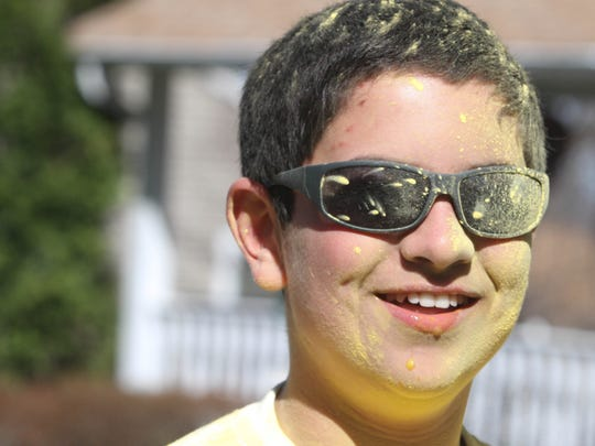 Bruno Silva, 13, stops after passing the yellow color throw at the Do or Dye 5K, a color run for the American Cancer Society, at Turkey Brook Park in Budd Lake on April 25, 2015.