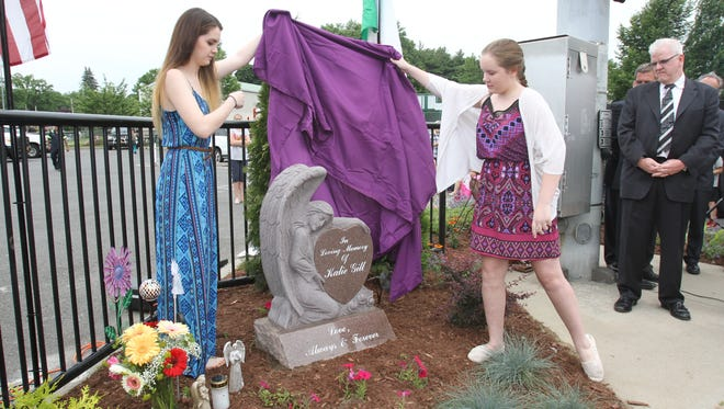 From left, Jamie Gill and Lindsey Gill unveil a memorial for their sister Kalie Gill at Coyne Park in Yonkers June 17, 2015.  Kalie Gill was tragically killed when a Jeep went out of control near St. Paul the Apostle Church carnival in Coyne Park on Oct. 11, 2013.