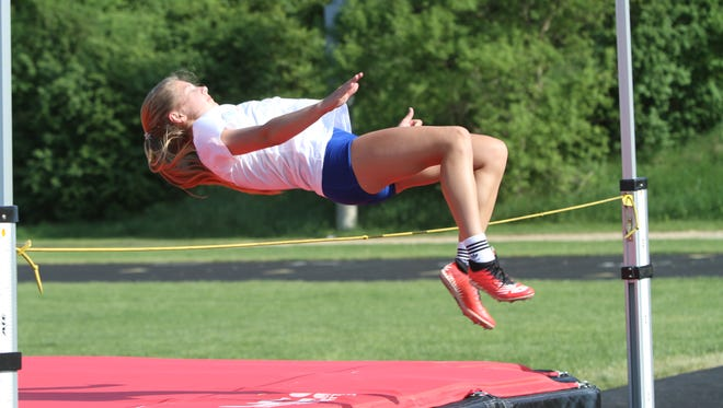 Paige Gallentine, who has qualified for the state meet in four events, practices the high jump on Tuesday, May 29, 2018 at Pathfinder Middle School in Pinckney.