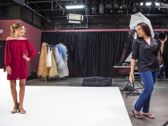 Fashion photographer Gianna Nicole photographs Temi Morgan, 13, in a studio in Phoenix, Friday, March 16, 2018.
