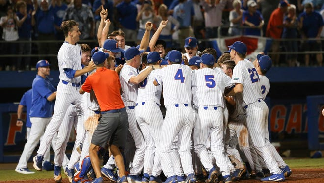 Florida celebrates after Austin Langworthy's home run sent the Gators to the College World Series.