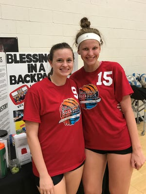 """Livonia Churchill varsity volleyball players (from left) Elizabeth Profit and Summer Clark both said it was a good feeling to help collect food for kids through """"Blessings in a Backpack."""""""
