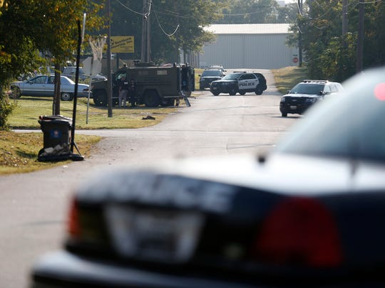 Police surround a house at 1400 West Phelps after a disturbance on Tuesday, Sept. 19, 2017.