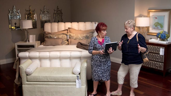 Designer Maria Panetta, left, helps Linda Parsons Fraga pick out furniture to update her home at Clive Daniel Home in Naples.