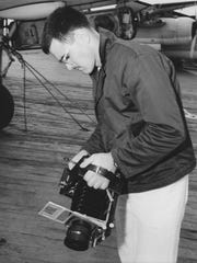 A photo of Hirneisen on the flight deck of the USS