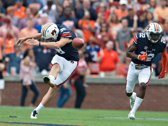 Auburn place kicker Daniel Carlson (38) kicks off during the NCAA football game between Auburn and Ole Miss on Saturday, Oct. 7, 2017, in Auburn, Ala.