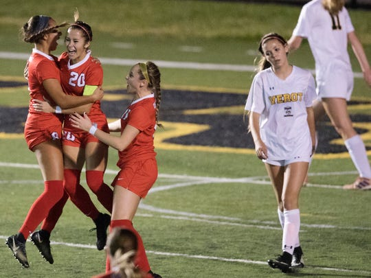 KINFAY MOROTI/THE NEWS-PRESS… Oxbridge Academy players celebrate scoring a goal against Bishop Verot High School on Friday (2/16/18) in the Class 2A girls soccer state semifinal at Bishop Verot High School in Fort Myers.