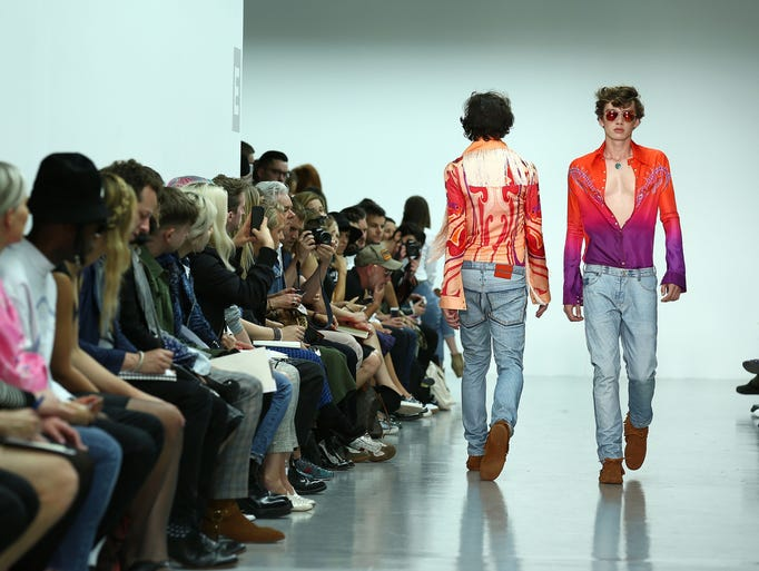 LONDON, ENGLAND - JUNE 17:  A model walks the runway at the Katie Eary show during the London Collections: Men SS15 at Victoria House on June 17, 2014 in London, England.  (Photo by Tim P. Whitby/Getty Images)