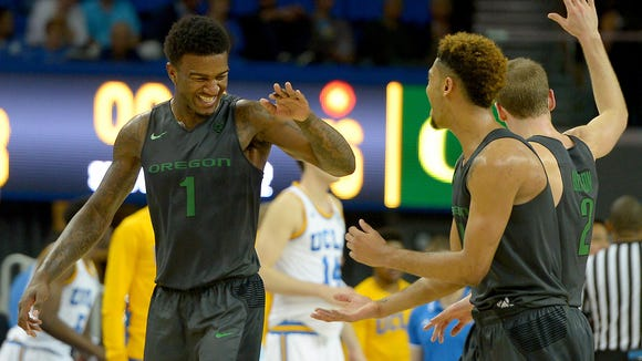Mar 2, 2016; Los Angeles, CA, USA; Oregon Ducks forward Jordan Bell (1) and guard Tyler Dorsey (5) celebrate after defeating the UCLA Bruins at Pauley Pavilion. Oregon won 76-68. Mandatory Credit: Jayne Kamin-Oncea-USA TODAY Sports