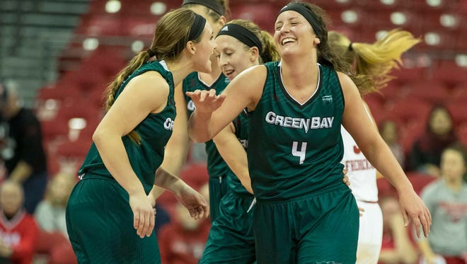 UWGB's Caitlyn Hibner (4) scored a career-high 19 points to help lead the Phoenix to a lopsided win over Wisconsin.