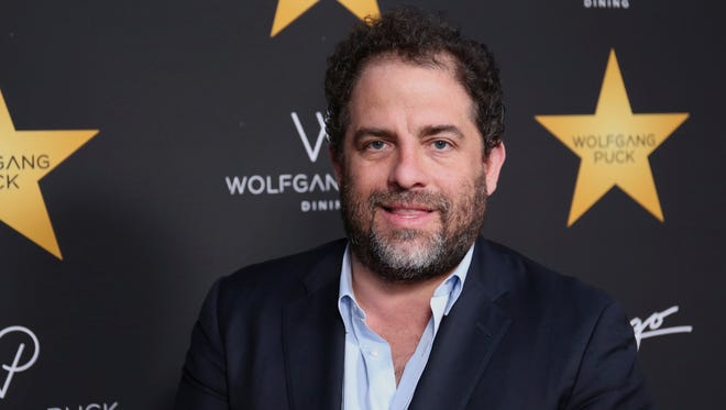 Brett Ratner, seen here in April 2017, has removed himself from any of his company's Warner Bros. projects and sued a woman over a Facebook post claiming he raped her.