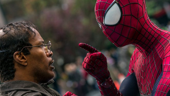 """Before he's turned into Electro, Max Dillon (Jamie Foxx) has a chance meeting with Spidey (Andrew Garfield) in """"The Amazing Spider-Man 2."""""""