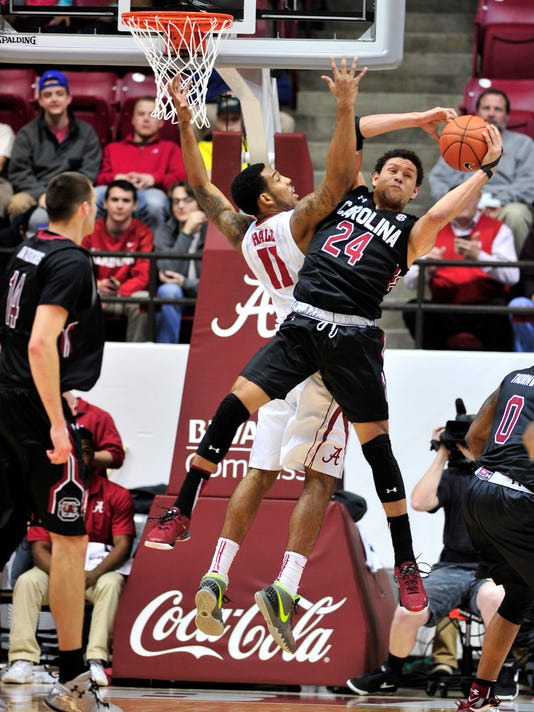 South Carolina forward Michael Carrera (24) grabs a rebound over Alabama forward Shannon Hale (11) during the first half of an NCAA college basketball game, Wednesday, Jan. 13, 2016, in Tuscaloosa, Ala. (AP Photo/Eric Schultz)