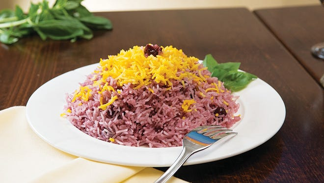 albaloo polo, rice mixed with sweet and sour cherries