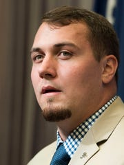 Alabama center Ross Pierschbacher talks during SEC
