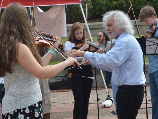 ANI Dragon Boats  John Dechiaro (right) directs members of the youth string orchestra in a performance at River Fete held Saturday, May 10, 2014 in downtown Alexandria.-Melinda Martinez/mmartinez@thetowntalk.com