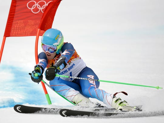 United States' Ted Ligety passes a gate in the first run of the men's giant slalom at the Sochi 2014 Winter Olympics, Feb. 19, 2014, in Krasnaya Polyana, Russia.