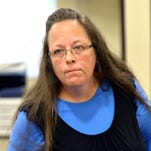 Rowan County Clerk Kim Davis listens to a customer following her office's refusal to issue marriage licenses at the Rowan County Courthouse in Morehead, Kentucky on Tuesday. Although her appeal to the U.S. Supreme Court was denied, Davis still refuses to issue marriage licenses.