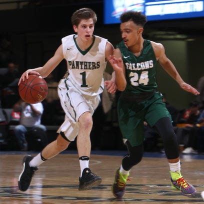 Pleasantville's Mike Manley is guarded by Woodlands'