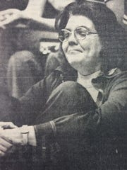 Louise Drummond relaxes after the Adena girls basketball team's 37-35 state championship victory over Cleveland Lutheran West in 1976.