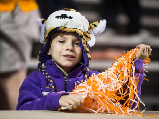 A young fan smiles before a game between Tennessee and LSU at Neyland Stadium in Knoxville, Tenn., on Saturday, Nov. 18, 2017.