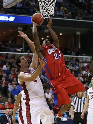 Dayton Flyers guard Jordan Sibert (24) lays the ball up defended by Stanford Cardinal center Stefan Nastic (4) during the second half in the semifinals of the south regional of the 2014 NCAA Mens Basketball Championship tournament March 27.