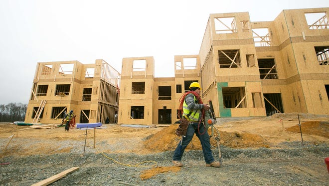 Workers build an apartment complex on Stanton Christiana Road near Christiana Mall. New Castle County officials are reworking code regulations that involve projects in unincorporated parts of the county.